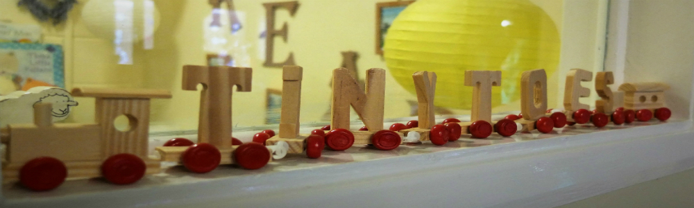 Tiny Toes Hertford homepage image of wooden train