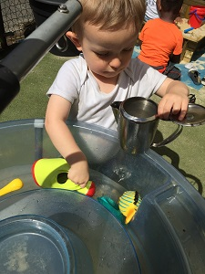Water play in the garden at Tiny Toes Hertford
