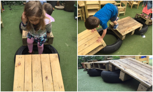 Outdoor play on obstacle course at Tiny Toes Hertford Day Nursery and Pre-school