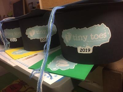 Tiny Toes Hertford School readiness image of graduation hats